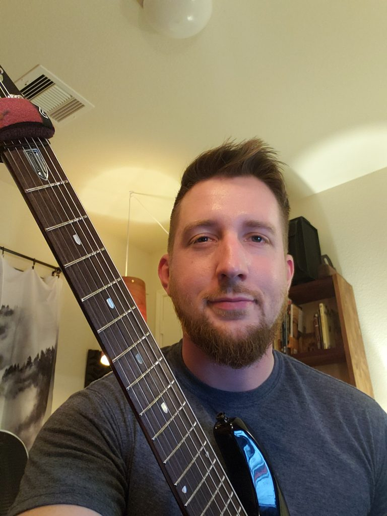 Temple Of Shred testimonials, Guitarist Mentorship Program: Eric G. with his guitar
